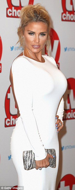 A figure-hugging number: Loose Women panellist Katie, 38, opted for a more classic red carpet look, and chose to wear a flowing white ballgown