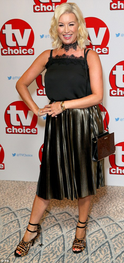 A really wild look: Denise Van Outen, the shows presenter, teamed a high-neck black top with a floaty metallic skirt, before rounding her look off with a fierce pair of Cheetah-print heels