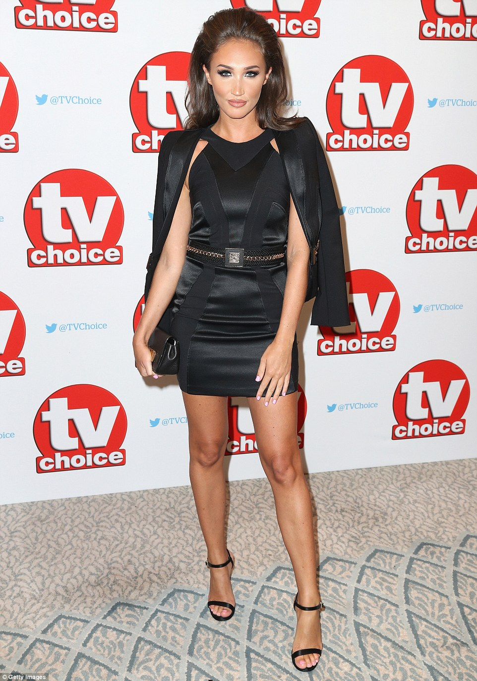 Back in black: Show newcomer Megan went for a vampy black mini dress which she teamed with towering heels and a tuxedo jacket
