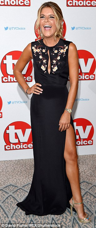 Daring: Emmerdale actress Gemma Oatengave a saucy hint of her cleavage in a cut-out black maxi dress