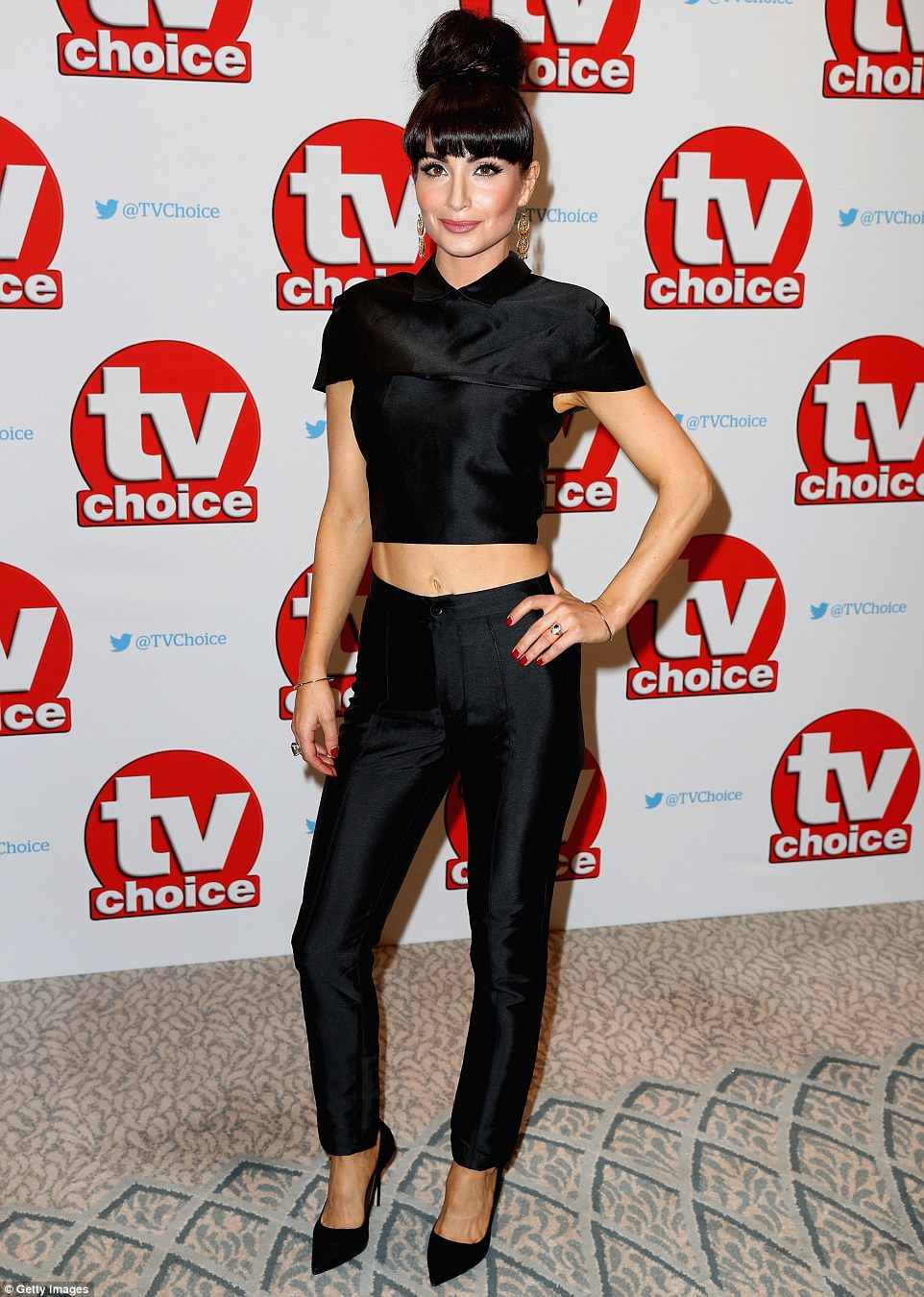 Village heart-breaker: Roxy Shahidi arrived in a skin-tight black ensemble, flashing her taut tummy as she stunned on the red carpet