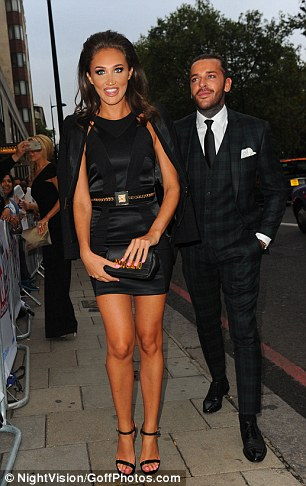Leggy: Megan showed off her long lithe legs in a satin mini dress with an intricate halterneck