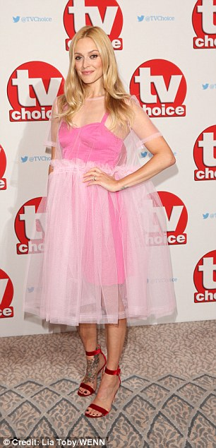 Candyfloss-chic:Wearing a pink tutu-style dress with sheer overlay, the mother-of-two showed off her unique style