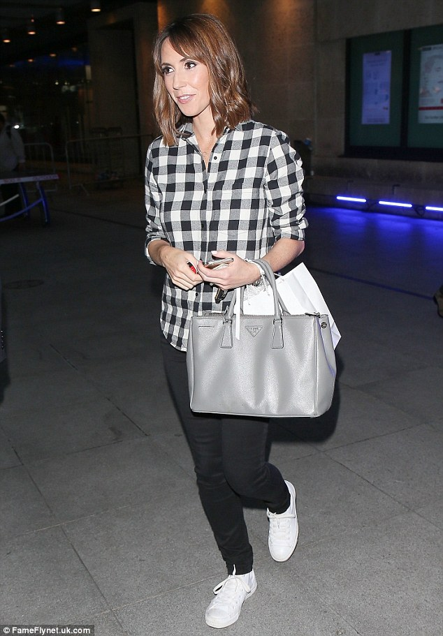Monochrome maven: She rocked a pair of super-skinny black jeans that flaunted her svelte legs