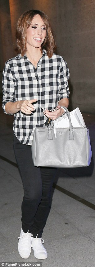 Opting for comfort: She accessorised with some white trainers and a sleek grey Prada handbag
