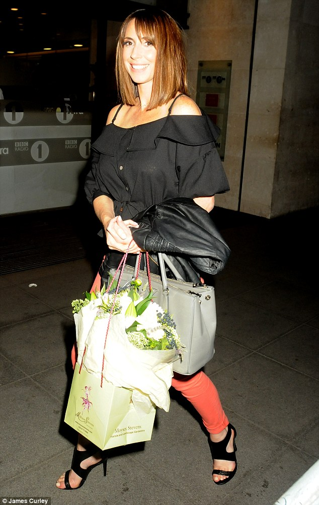 Glowing:The 39-year-old looked radiant as she headed home from the London studios with a huge bouquet of gorgeous white flowers in hand