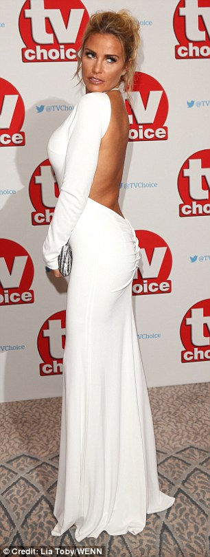 All white on the night: Katie Price opted for a restrained white number when she took to the red carpet at the TV Choice Awards on Monday night