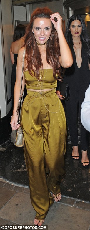 Striking:The palazzo trousers flowed from the waistband to the floor, elongating her already leggy frame