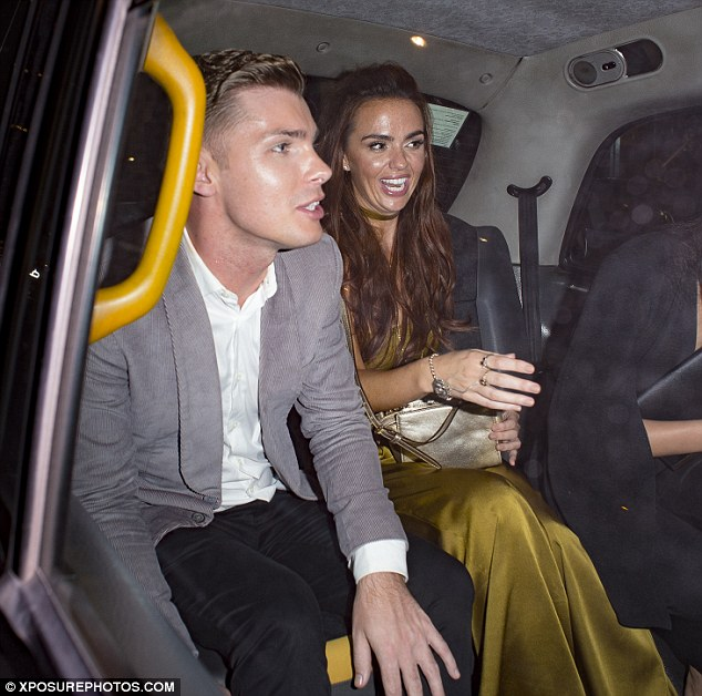And they're off: Jennifer and Kieron set off in the back of a cab following their appearance at the event on Monday evening