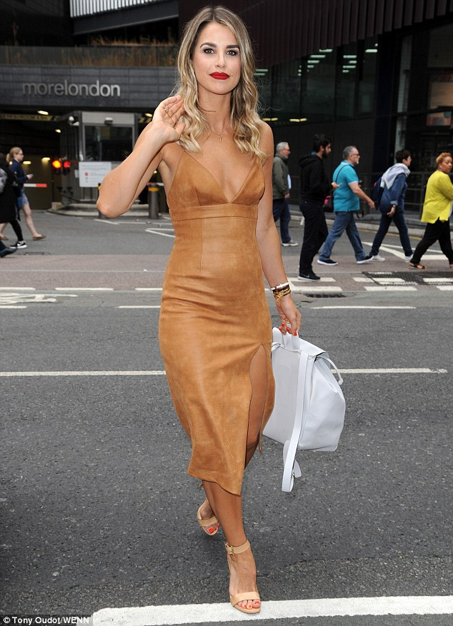 Dressed to impress: Vogue Williams was showcasing the fruits of her labour in the gym as she headed to the Walkers Sarnie Club launch party in London on Tuesday