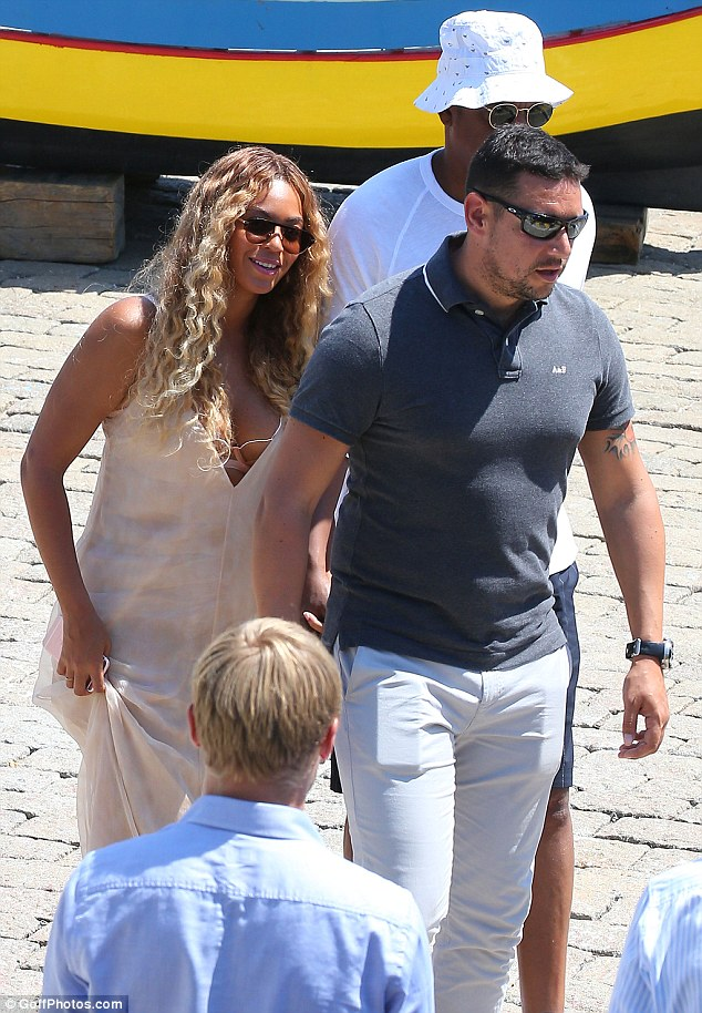She's so down-to-earth: Beyonce looked lovely as she went barefoot in a low-cut blush-coloured gown