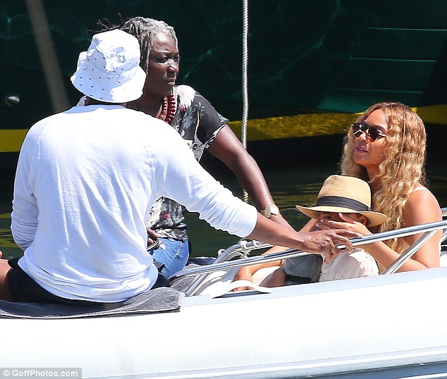 Relaxing: Beyonce was spotted wrapping an arm around Blue Ivy as they chatted to friends on the boat