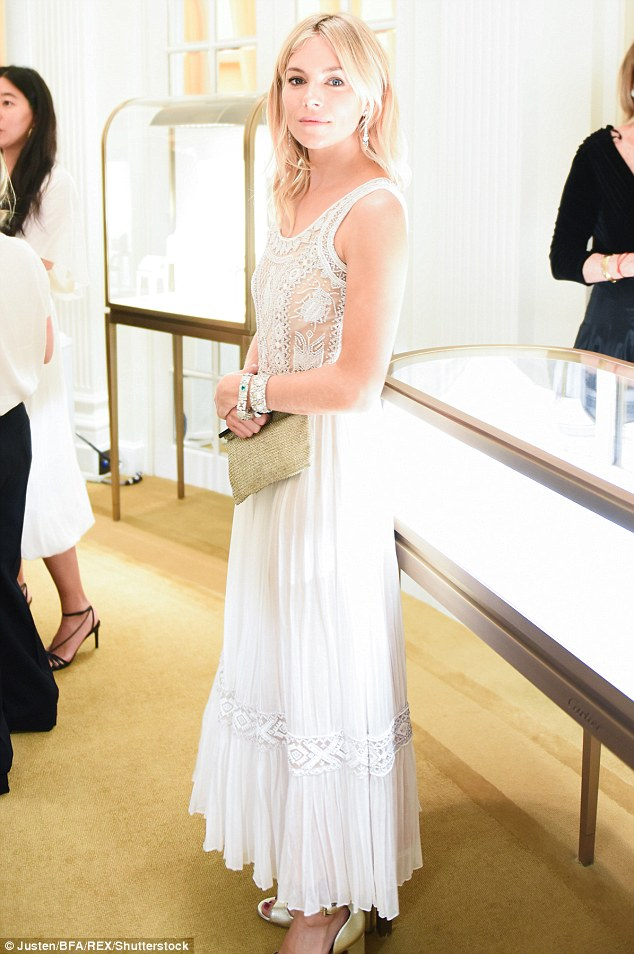 Radiant: Sienna looked stunning in her floaty white ensemble