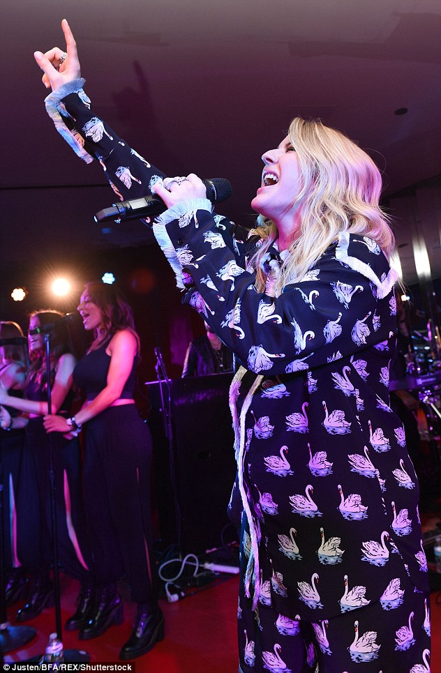 Seeing stars: Ellie threw her hands in the air as she performed in front of the crowds