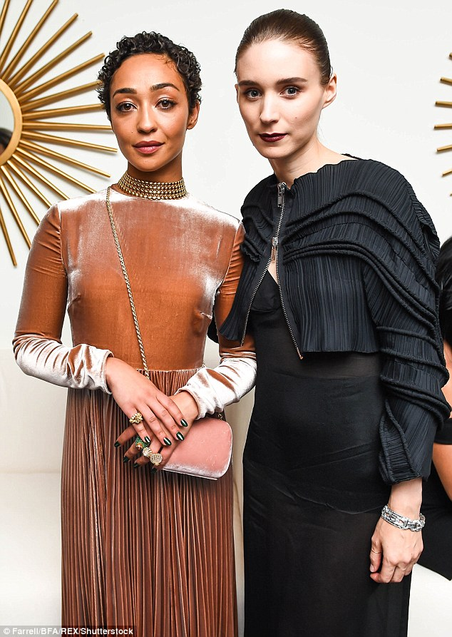 Ladies who party: British actress Ruth Negga and Rooney pose for the camera