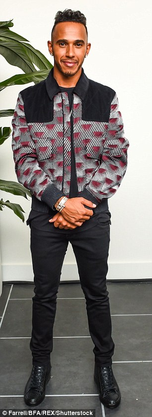 Lewis Hamilton sported a patterned jacket and jeans