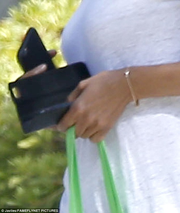 Where'd it go? Halle's finger was mysteriously free of her wedding band