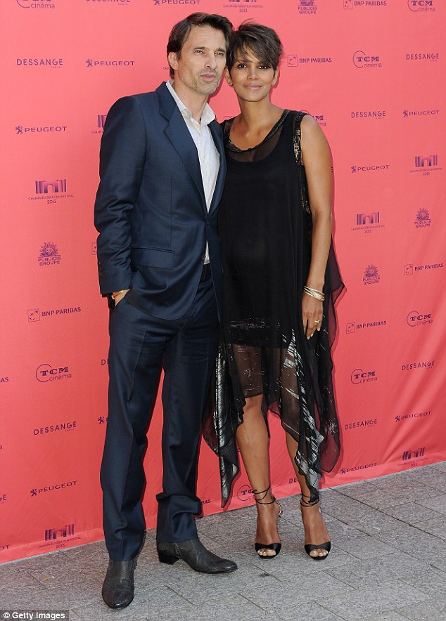 Still married:They filed divorce papers in October, but despite citing irreconcilable differences as a motive for their abrupt separation, Halle and estranged husband  Martinez are reportedly in no hurry to finalise proceedings