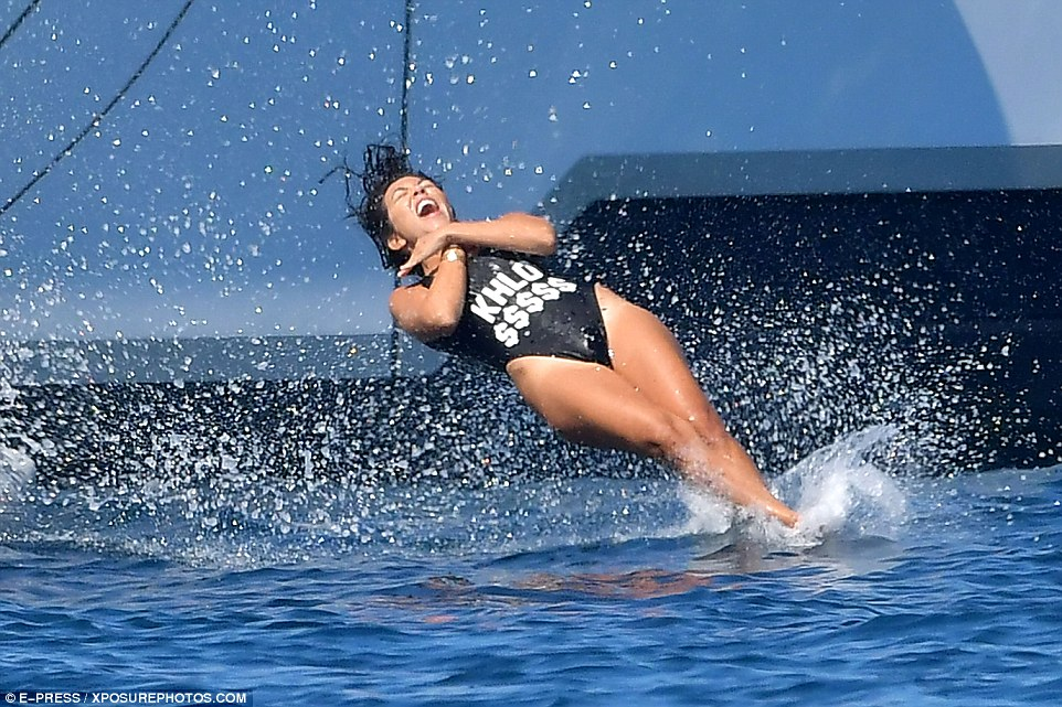 Carefree: She was seen hitting the surf near her luxury liner on Tuesday afternoon