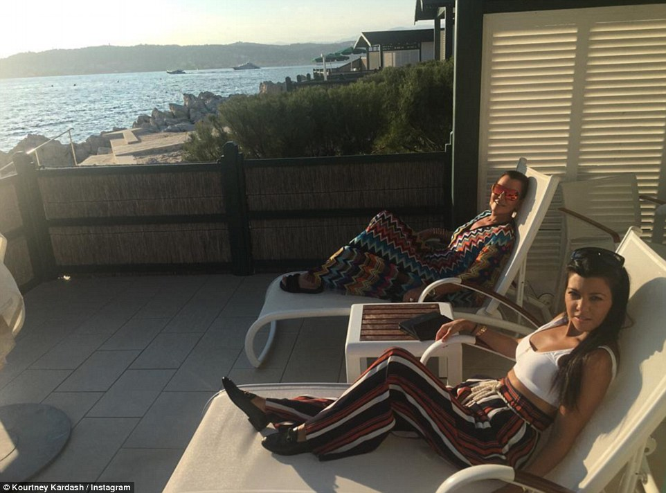 Holiday vibes: Kourtney shared this fashion led picture of herself and her mother as they relaxed on sun loungers