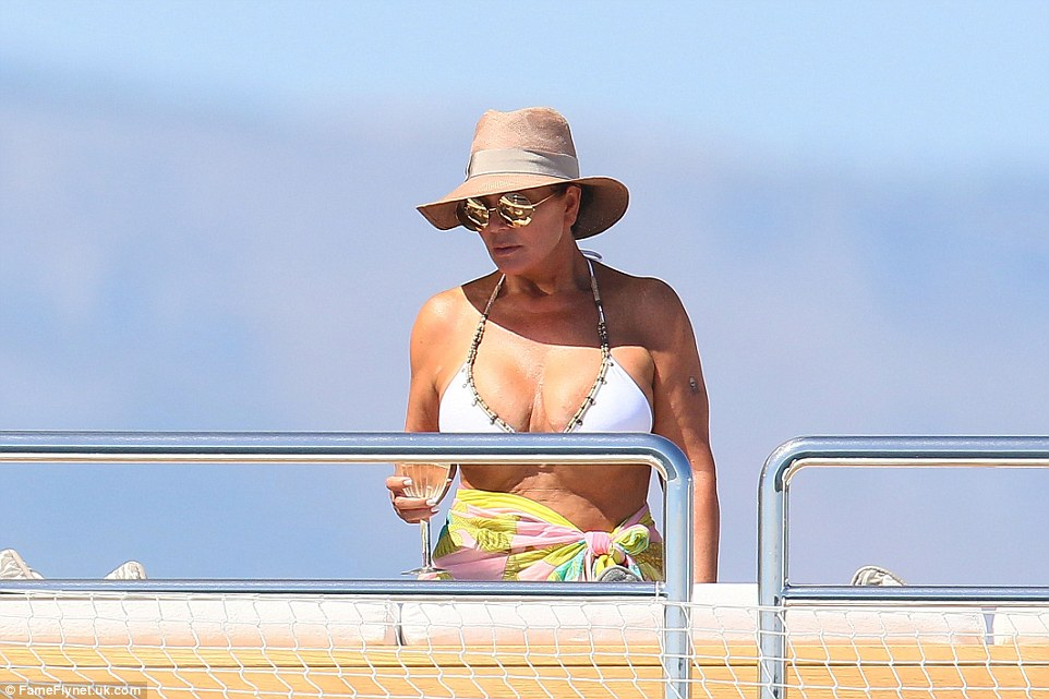 White hot: Kris looked much more calmer as she showed off her impressive assets in a tiny white bikini
