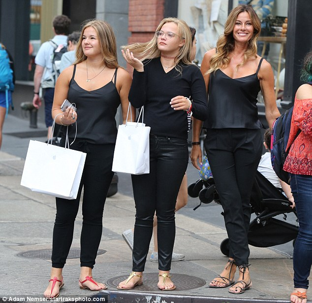 Girls' day! The threesome, dressed in similar black attire, picked up goodies from NYC-area Apple store