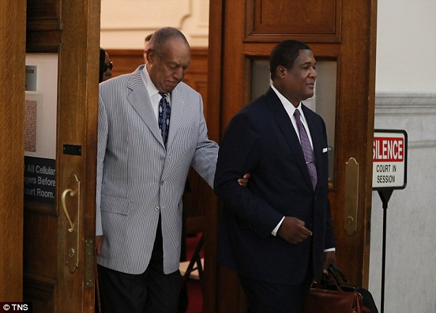 Bill Cosby's legal defense team is blaming racial prejudice and 'a barrage of new accusers' for the criminal sex-assault charges lodged against the actor in Pennsylvania. Cosby is pictured above with his spokesman Andrew Wyatt on Tuesday