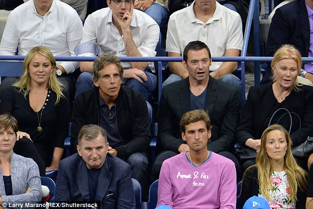 Did you see that? Ben Stiller (centre left) and Hugh Jackman (centre right) look captivated by the on-court action