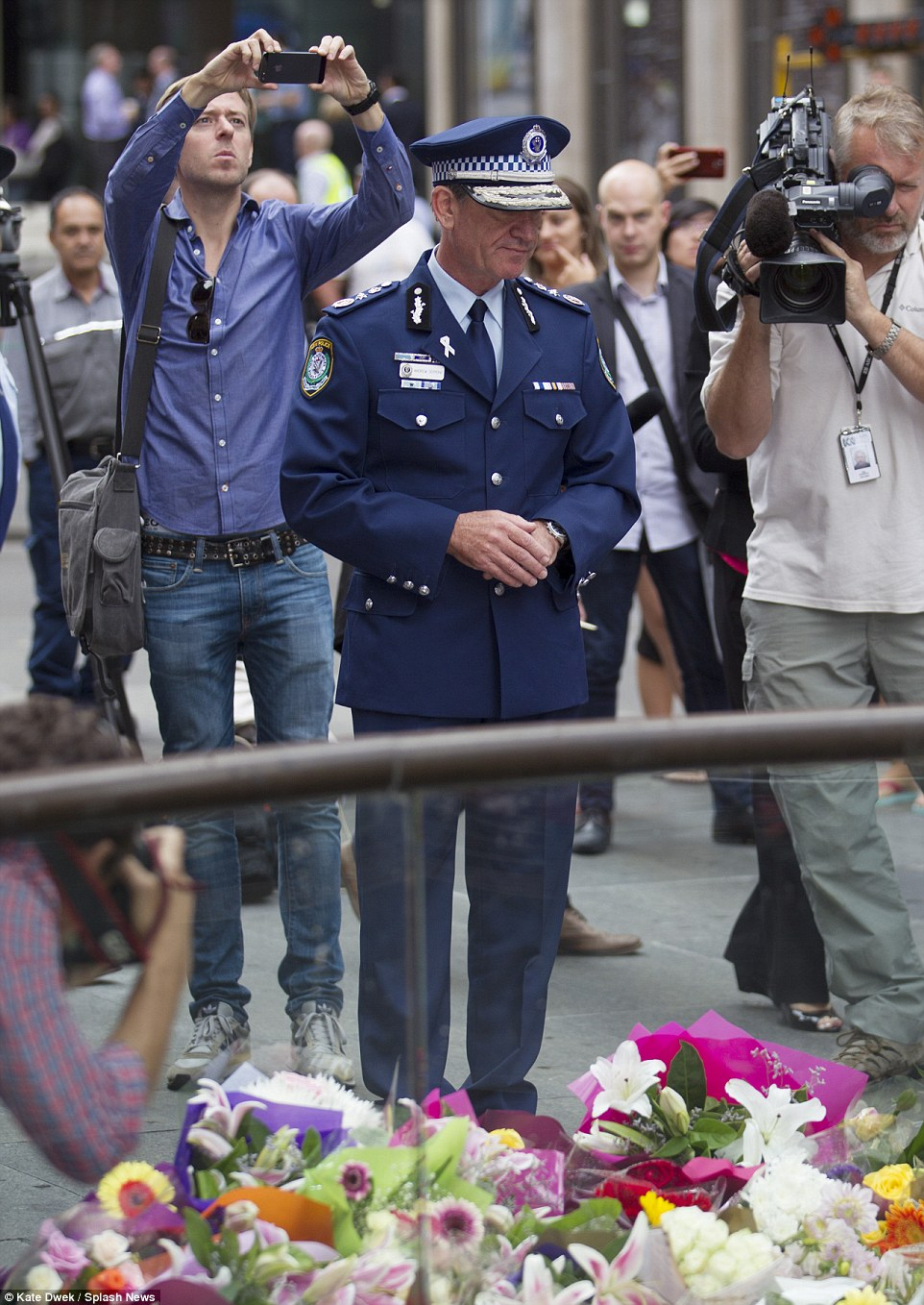 Police Commissioner Andrew Scipione paid his respects to the two innocent siege victims