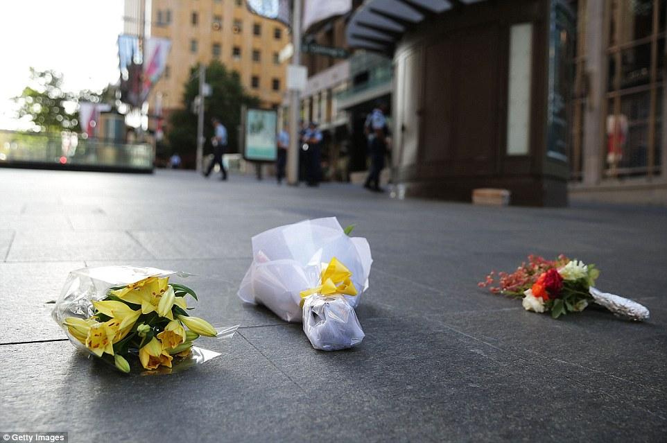 The first flowers were laid in Martin Place around sunrise on Tuesday, just hours after the siege