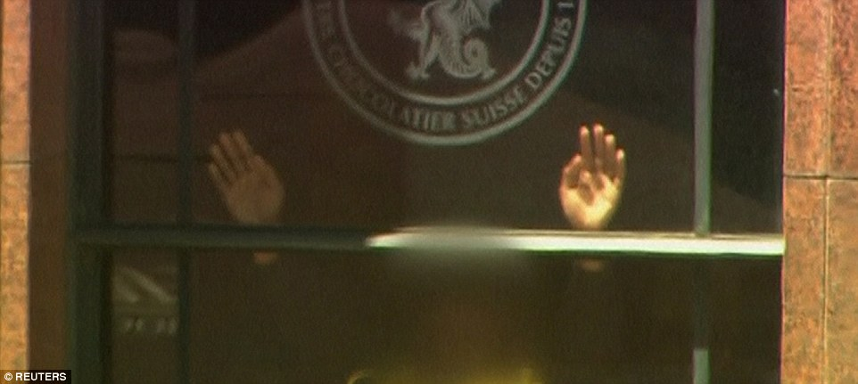 A hostage could be seen pressing their hands up against the window of the cafe