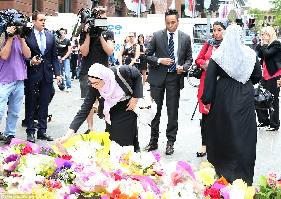 Hundreds of bouquets of flowers have been laid in Martin Place since dawn