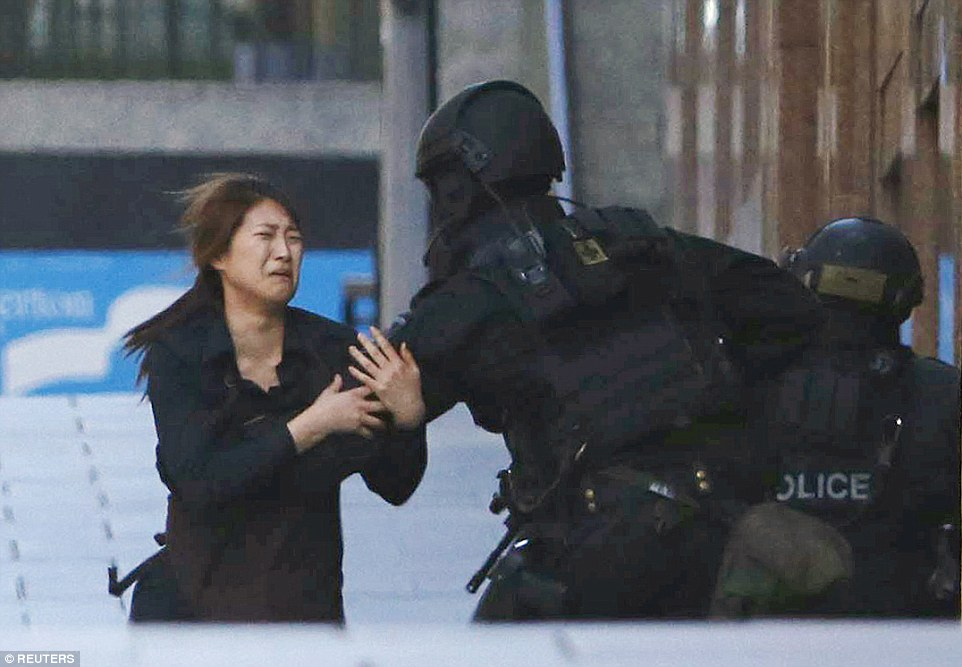 One of the young female employees was visibly upset as she grabbed hold of armed police