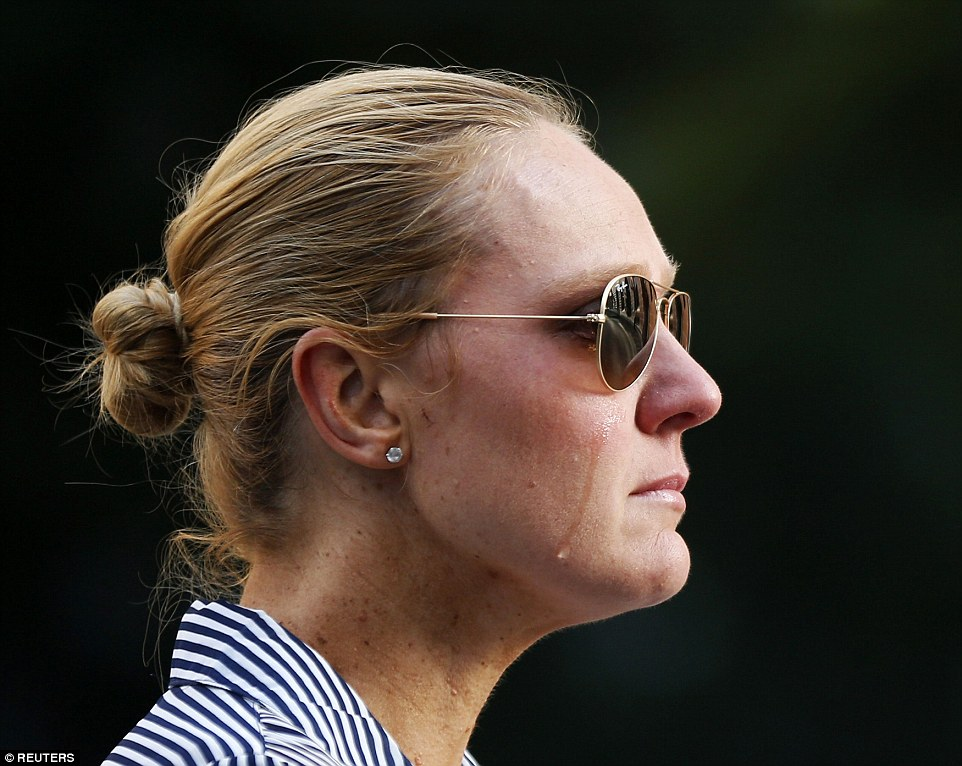 Sydney resident Kate Golder cries as she observes the site of a cafe siege in Martin Place