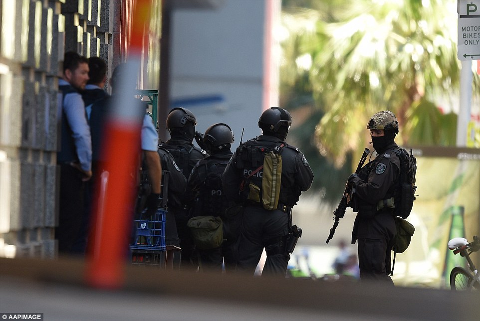 Police heavily armed with weapons covered all corners of Martin Place