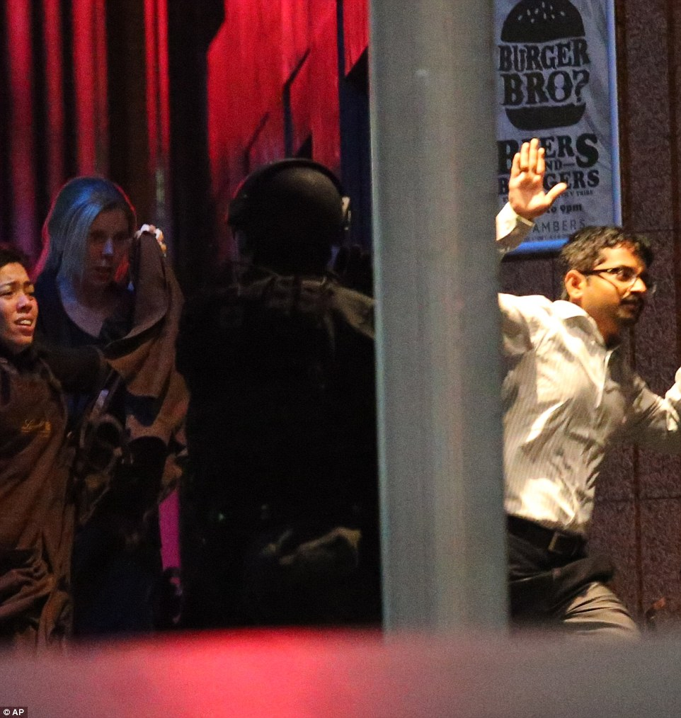 Police raided the cafe in central Sydney early Tuesday, bringing a dramatic end to a 17-hour siege. The raid came moments after some hostages fled the Lindt cafe after more than 16 hours