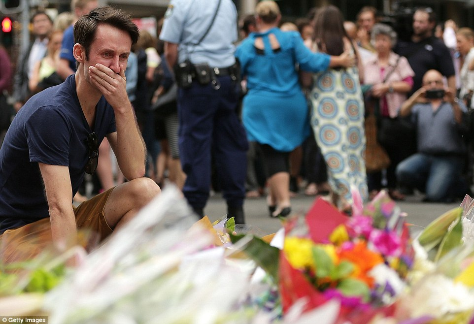 Shock: Many of those office workers, friends and tourists leaving tributes in Sydney were in tears