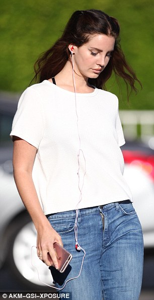 Luscious locks: The brunette beauty wore her chestnut tresses down with each half swept back to feature her stunning looks