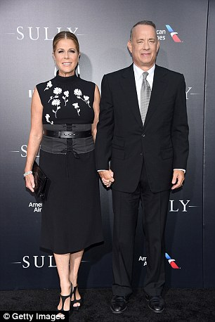Hanks, pictured with his wife Rita Wilson, at the premiere, plays the role of hero pilot