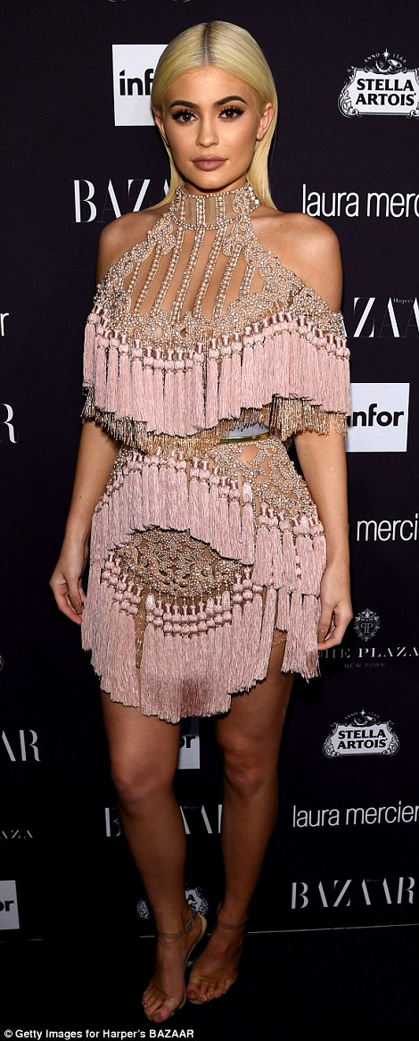 Pretty in pink:The 19-year-old Keeping Up With The Kardashians star donned an interesting pale pink fringed mini dress with beaded embroidery and cut-out shoulders