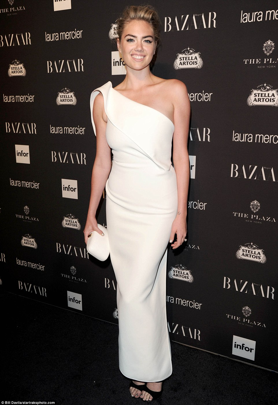 Angelic:Kate Upton looked like an angel in a long white one-shoulder gown which she teamed with a pair of black open toe heels
