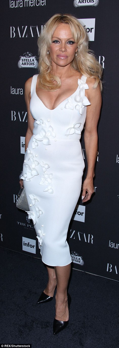 More white!The blonde bombshell also opted for a white number with black pumps. The 49-year-old Baywatch alum looked sexy in the curve-hugging midi-frock with floral appliques