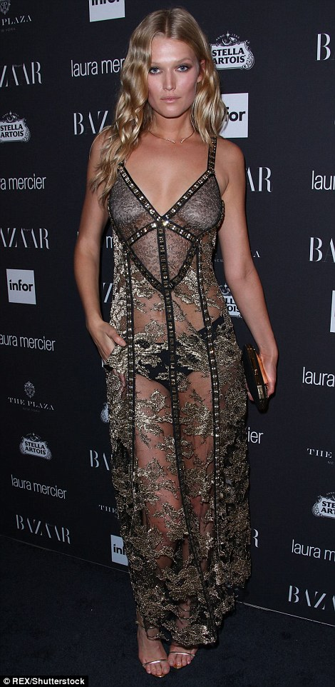 Golden girls: Toni Garrn and Barbara Fialho (L-R) shimmered on the carpet in gold floor-length dresses, with Toni opting for a racy semi-sheer look while Barbara chose a glamorous strappy gown