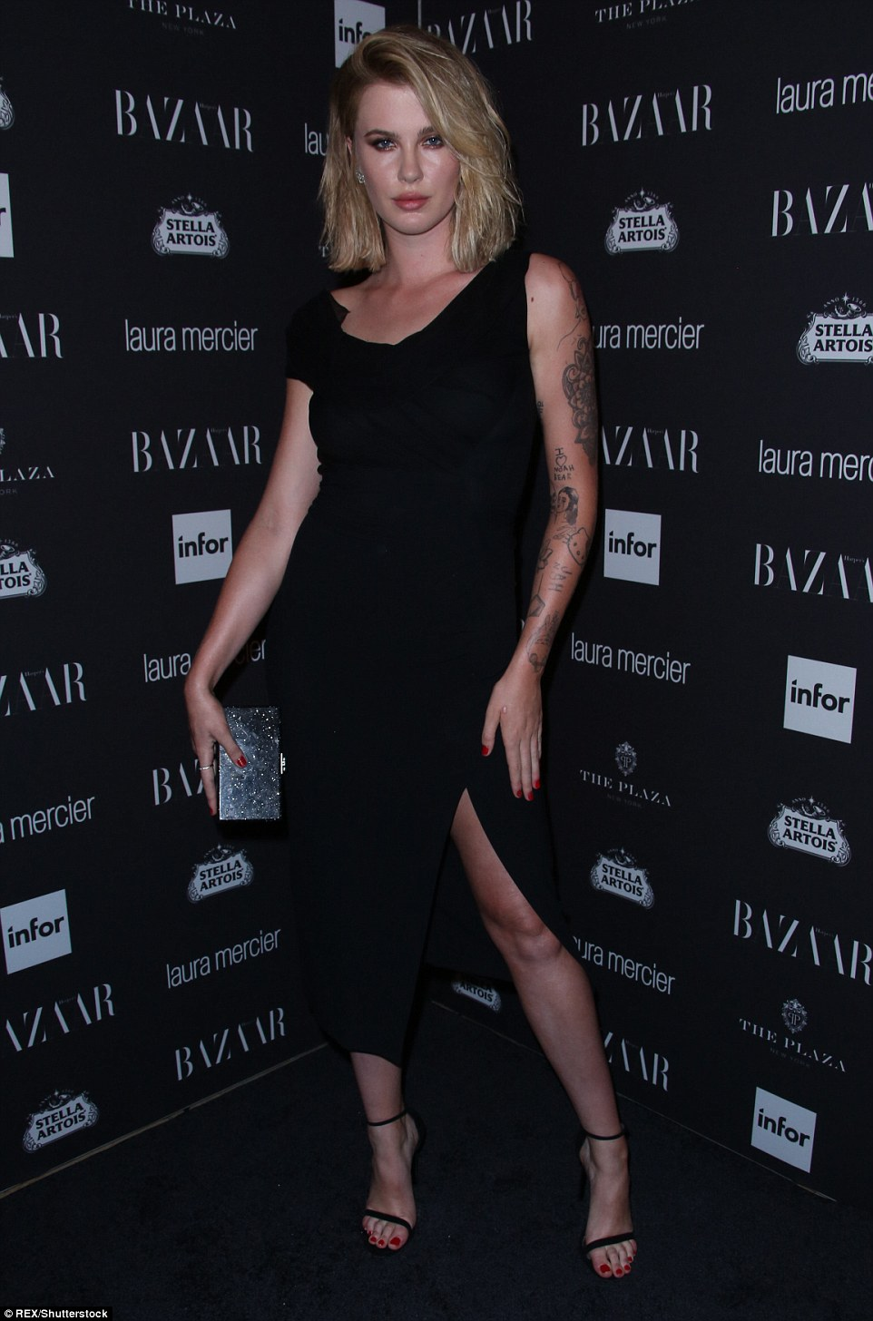 Good genes: Hailey Baldwin's model cousin Ireland showed a bit of leg in her black midi frock, featuring a thigh-high split at the front