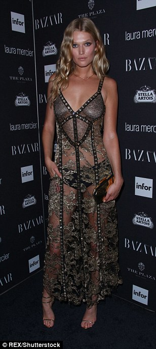 Ravishing: Hilary Rhoda was riveting in red while Jessica Hart styled a sheer frock with red lipstick and sleek tresses and Toni Garrn amazed in a totally sheer dress