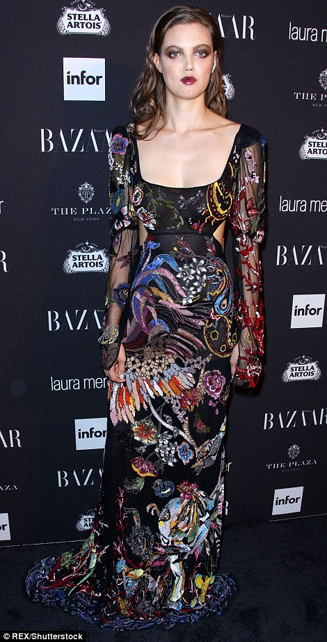 Model material: Fashion models Nicole Trunfio and Lindsey Wixson (L-R) put on their expected fashionable displays in extravagant dresses of rich colours