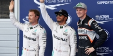 Hamilton takes pole in rain-hit session