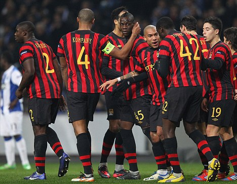 Target: Manchester City's Mario Balotelli (centre) was racially abused in Porto