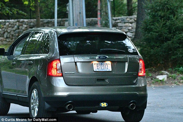 A grey SUV with medical plates issued by the state of New York was spotted outside Clinton's house parked in front of a set of concrete barriers that are guarded by police officers and Secret Service agents