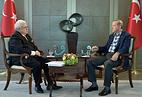 Turkish President Recep Tayyip Erdogan and TASS First Deputy Director-General Mikhail Gusman